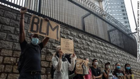 Small crowds gather outside the US Embassy in Hong Kong.