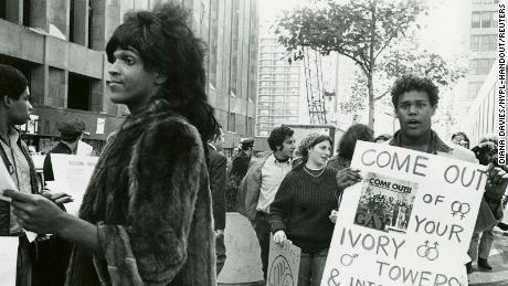 Marsha P. Johnson handing out flyers in support of gay students at New York University in 1970.