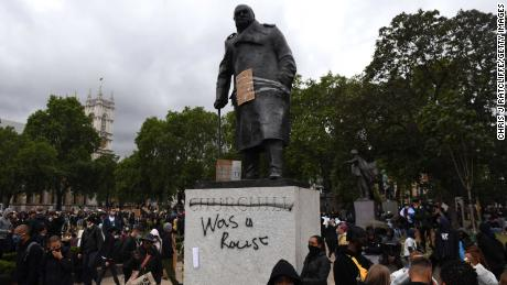 """A statue of Winston Churchill outside Parliament was daubed with the words, """"was a racist,"""" during a protest in June."""