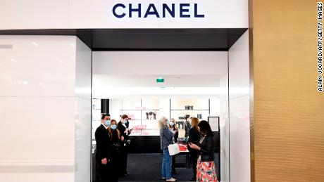 Shop assistants welcoming customers to Chanel at Galeries Lafayette, on the first day of the department store's reopening in Paris in May.