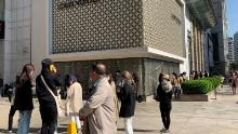 """Shoppers lining up to enter a Louis Vuitton boutique in Seoul in May. """"South Korea is almost mirroring what's happening in China,"""" said Fflur Roberts, an analyst at Euromonitor."""