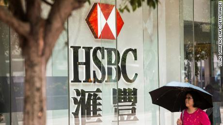 A pedestrian walking past HSBC in Hong Kong in 2017.