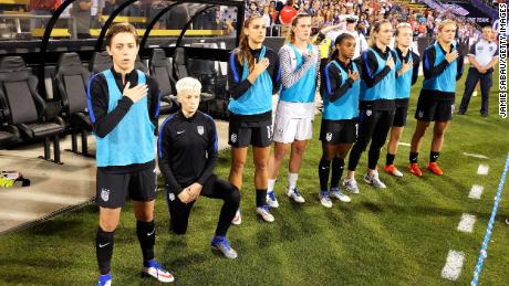 Rapinoe takes the knee before a match against Thailand in 2016.