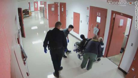 Officers place Sterling Higgins into a restraint chair in the Obion County Jail in Union City, Tennessee.