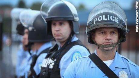 Police are deployed to keep peace along Florissant Avenue in Ferguson, Missouri, in August 2014, a week after Michael Brown was shot and killed in the neighborhood, sparking violent protests.