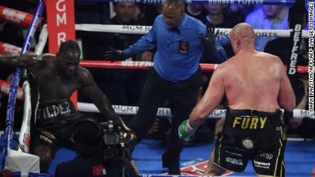 Fury knocks US boxer Deontay Wilder down before defeating him.