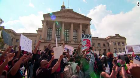 Protesters spanning many ages and races demand change outside the Georgia state Capitol.
