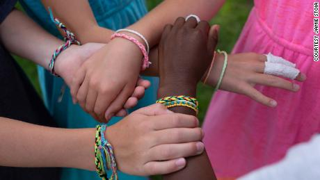 Kamryn and friends wearing friendship bracelets they made.