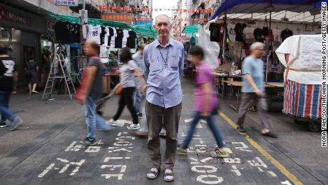 Father John Wotherspoon has worked with accused drug traffickers in Hong Kong to try to track down drug lords.