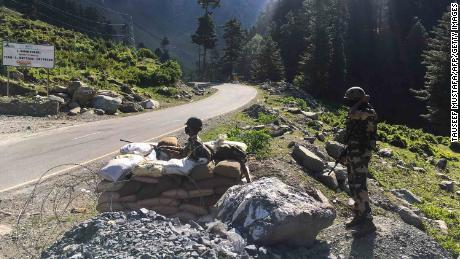 Indian Border Security Force soldiers guard a highway leading towards Leh, bordering China, in Gagangir on June 17, 2020.