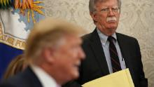 Then-national security adviser John Bolton listens to President Donald Trump during a meeting with Egyptian President Abdel-Fattah el-Sisi in April 2019.