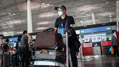 A man wearing a face mask and goggles at Beijing Capital International Airport on June 17.