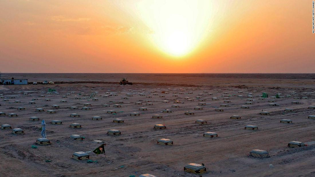 The sun sets over a cemetery for coronavirus victims near Najaf, Iraq, a giugno 10.