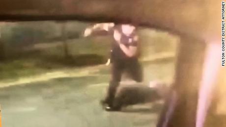 A still photo that a prosecutor says shows Officer Garrett Rolfe kicking Rayshard Brooks