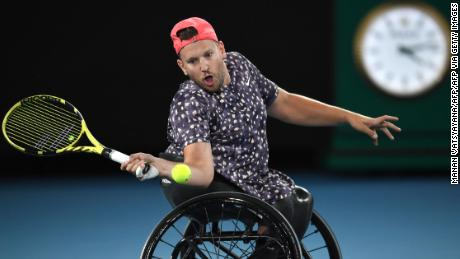 Dylan Alcott hits a return during the men's wheelchair singles final at the Australian Open.