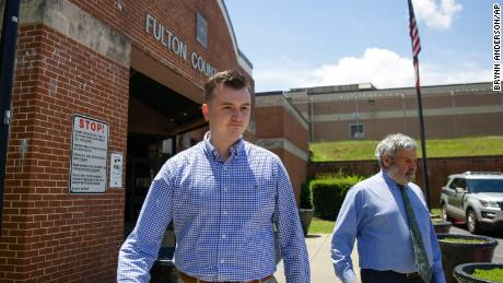 Former officer Devin Brosnan walks out of the Fulton County Jail on bail after his release Thursday.