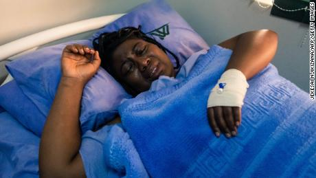 Joana Mamombe lies on a hospital bed at a private hospital in Harare on May 15.