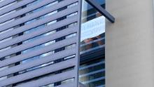 "A detainee holds a sign  to the window of his Kangaroo Point hotel room: ""Thank you."""