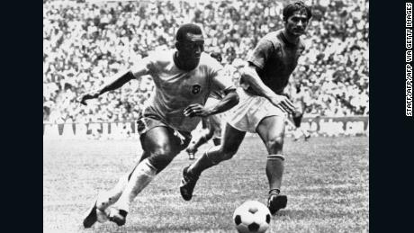 Pelé dribbles past Italian defender Tarcisio Burgnich, who later eulogized about the Brazil star.