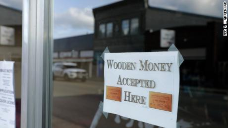 A sign on a business in Tenino, Washington, says they will be accepting wooden money.