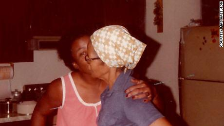 Mae Hazelton gives a kiss to her grandmother, Nellie Virginia Burkes.