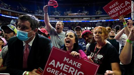 People cheer as they attend a campaign rally for President Donald Trump at the BOK Center, Saturday, June 20, in Tulsa, Oklahoma.