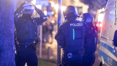 Police officers responding to riots in Stuttgart, Germany.