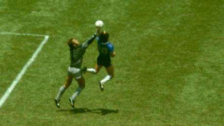 "Maradona outjumps Peter Shilton to score the ""Hand of God"" goal in the 1986 World Cup."