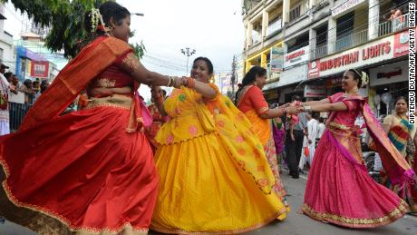 Indian devotees dance during Rath Yatra celebrations in Siliguri, West Bengal, on July 4, 2019.