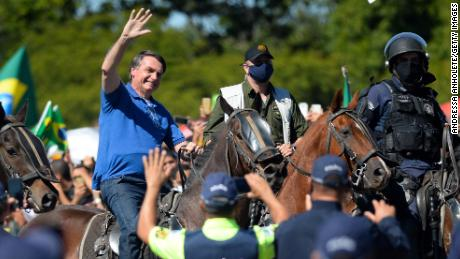 Brazilian President Jair Bolsonaro horse-riding during a demonstration in favor of his government in front of Planalto Palace on May 31, 2020