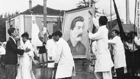 A portrait of Soviet leader Joseph Stalin is prepared for a parade in Pyongyang in July 1947.