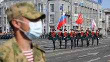 A Russian soldier wears a face mask in Lenin Square during the parade.