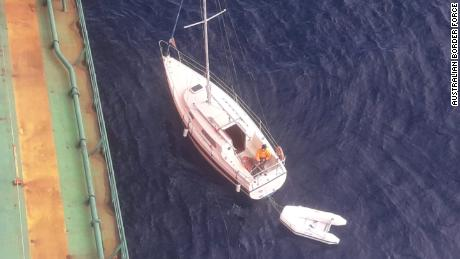 The cargo ship, headed for Newcastle, Australia, came to the assistance of the yacht.