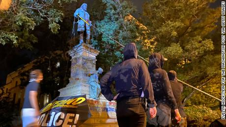 Demonstrators attempt to topple the Albert Pike statue in Washington, on Friday, June 19.