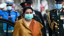 Nepal's leftist President Bidhya Devi Bhandari wore a mask to the parliament in Kathmandu on May 15 to present the new government's program.