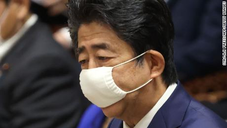 Japan's Prime Minister Shinzo Abe wearing a face mask amid concerns over the spread of coronavirus speaks during a budget committee session in the lower house at parliament in Tokyo on June 10, 2020.