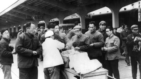 Chinese travelers buy their breakfast from a street vendor at Chunghow Railway Station in 1975. Premier Li Keqiang has suggested more street vendors could help fix a looming jobs crisis.