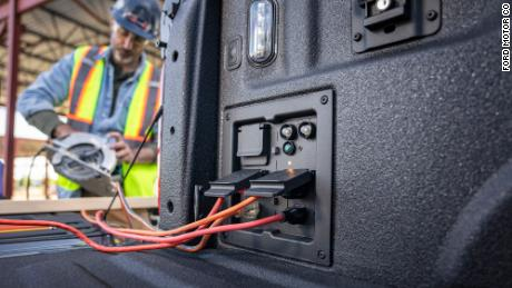 In the hybrid F-150, plugs in the bed can provide power for tools and lights.