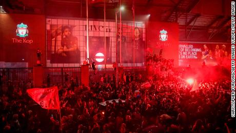 Liverpool fans celebrate at Anfield Stadium after wining the Premier League title.