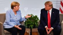 German Chancellor Angela Merkel and President Donald Trump speak during the G-7 summit in Biarritz, France, in August 2019.
