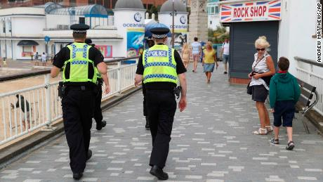 Police patrol near Bournemouth beach on June 26.