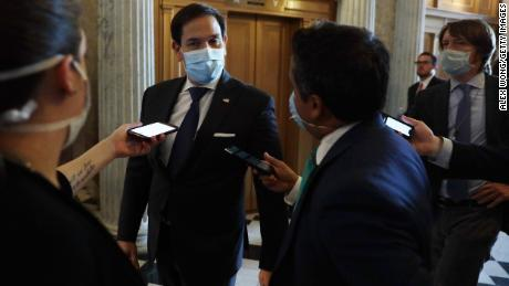 """Everyone should just wear a damn mask,"" says Republican Senator Marco Rubio. He followed his own advice as he arrived for a vote in Washington, DC, on June 14."