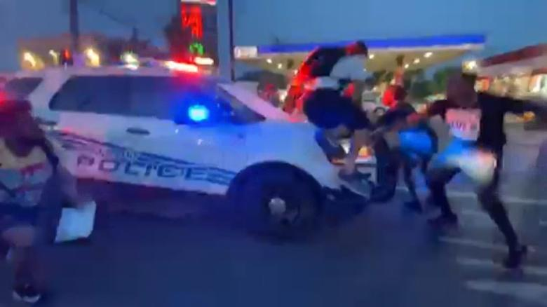 Detroit police cruiser drove through crowd of protesters, video shows