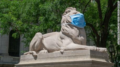 Patience and Fortitude, the twin lion sculptures that guard the New York Public Library in Bryant Park, now wear lion-sized face masks to encourage New Yorkers to keep wearing their masks, too.