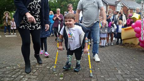Tony Hudgell, who uses prosthetic legs, takes the final steps in his fundraising walk in West Malling Kent, with mum, Paula and dad Mark. Five-year-old Tony has raised more than £1,000,000 for the Evelina London Children's Hospital, who have cared for him since he was four-months-old, by walking every day in June, covering a distance of 10 kilometres. (Photo by Gareth Fuller/PA Images via Getty Images)  Date created: June 30, 2020