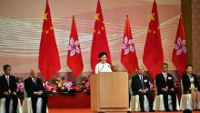 Hong Kong's Chief Executive Carrie Lam (C) speaks to guests following a flag-raising ceremony to mark China's National Day celebrations early morning in Hong Kong on July 1, 2020.