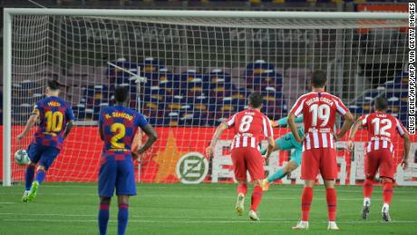 Barcelona's Lionel Messi scores a penalty to reach 700 career goals.