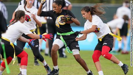 Players participate in the first day of games in the NFL Flag Football Championships.