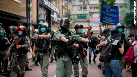 Police in riot gear are seen outside Hysan Place, an upscale shopping mall in Causeway Bay, ordering people to disperse.