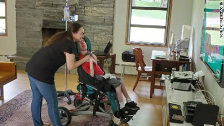 Ben, here with mom Joanne De Simone, has a  condition that makes coronavirus more dangerous to him, so he cannot get his usual in-person therapy and services.
